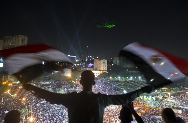 Flags_wave_Egypt_madness_AFP