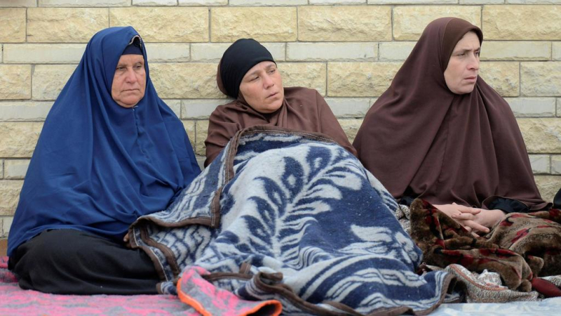 Relatives-of-victims-of-the-explosion-at-Al-Rawda-mosque-sit-outside-Suez-Canal-University-hospital-in-Ismailia-Egypt